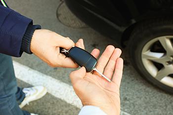 Buyer taking car key