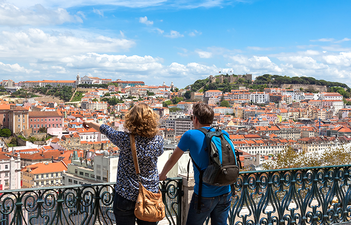 Tourist watching to Lisbon rooftop from Sao Pedro de Alcantara v