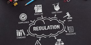 Regulations Chart with keywords and icons on blackboard